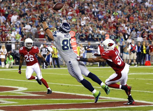 Seattle Seahawks tight end Zach Miller (86) pulls in a touchdown pass as Arizona Cardinals strong safety Yeremiah Bell (37) and Rashad Johnson (26) defend during the first half of an NFL football game, Thursday, Oct. 17, 2013, in Glendale, Ariz. (AP Photo/Rick Scuteri)