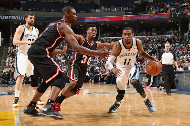 MEMPHIS, TN - APRIL 9: Mike Conley #11 of the Memphis Grizzlies handles the ball against the Miami Heat on April 9, 2014 at FedExForum in Memphis, Tennessee. (Photo by Joe Murphy/NBAE via Getty Images)