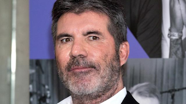 Simon Cowell, who seems to save his softer side for animals, helped a family retrieve a lost dog by offering a large reward. (Photo: Getty Images)