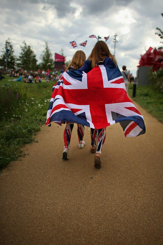 LONDON, ENGLAND - JULY 28:  Members of the public wearing Union Jack clothing arrive on day one of the London 2012 Olympic Games at the Olympic Park on July 28, 2012 in London, England.  (Photo by Jeff J Mitchell/Getty Images)