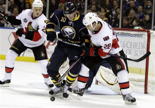Buffalo Sabres' Christian Ehrhoff (10), of Germany, battles for the puck with Ottawa Senators' Zenon Konopka (28) during the second period of an NHL hockey game in Buffalo, N.Y., Tuesday, Dec. 13, 2011. (AP Photo/David Duprey)
