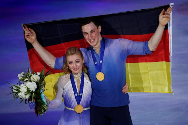 Figure Skating - World Figure Skating Championships - The Mediolanum Forum, Milan, Italy - March 22, 2018 Germany's Aljona Savchenko and Bruno Massot celebrate after winning the Pairs gold REUTERS/Alessandro Garofalo