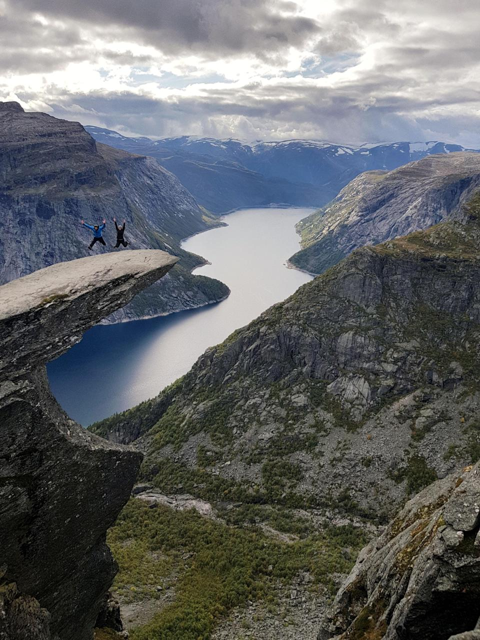 A couple of apparent daredevils on the Troll's Tongue (Trolltunga Adventures/Caters News)