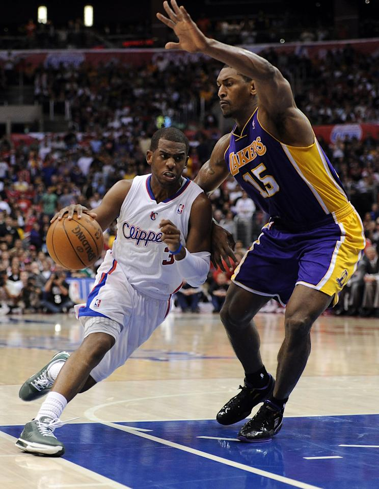 LOS ANGELES, CA - APRIL 04:  Chris Paul #3 of the Los Angeles Clippers drives to the basket on Metta World Peace #15 of the Los Angeles Lakers at Staples Center on April 4, 2012 in Los Angeles, California.  The Lakers won 113-108.  NOTE TO USER: User expressly acknowledges and agrees that, by downloading and or using this photograph, User is consenting to the terms and conditions of the Getty Images License Agreement.  (Photo by Harry How/Getty Images)