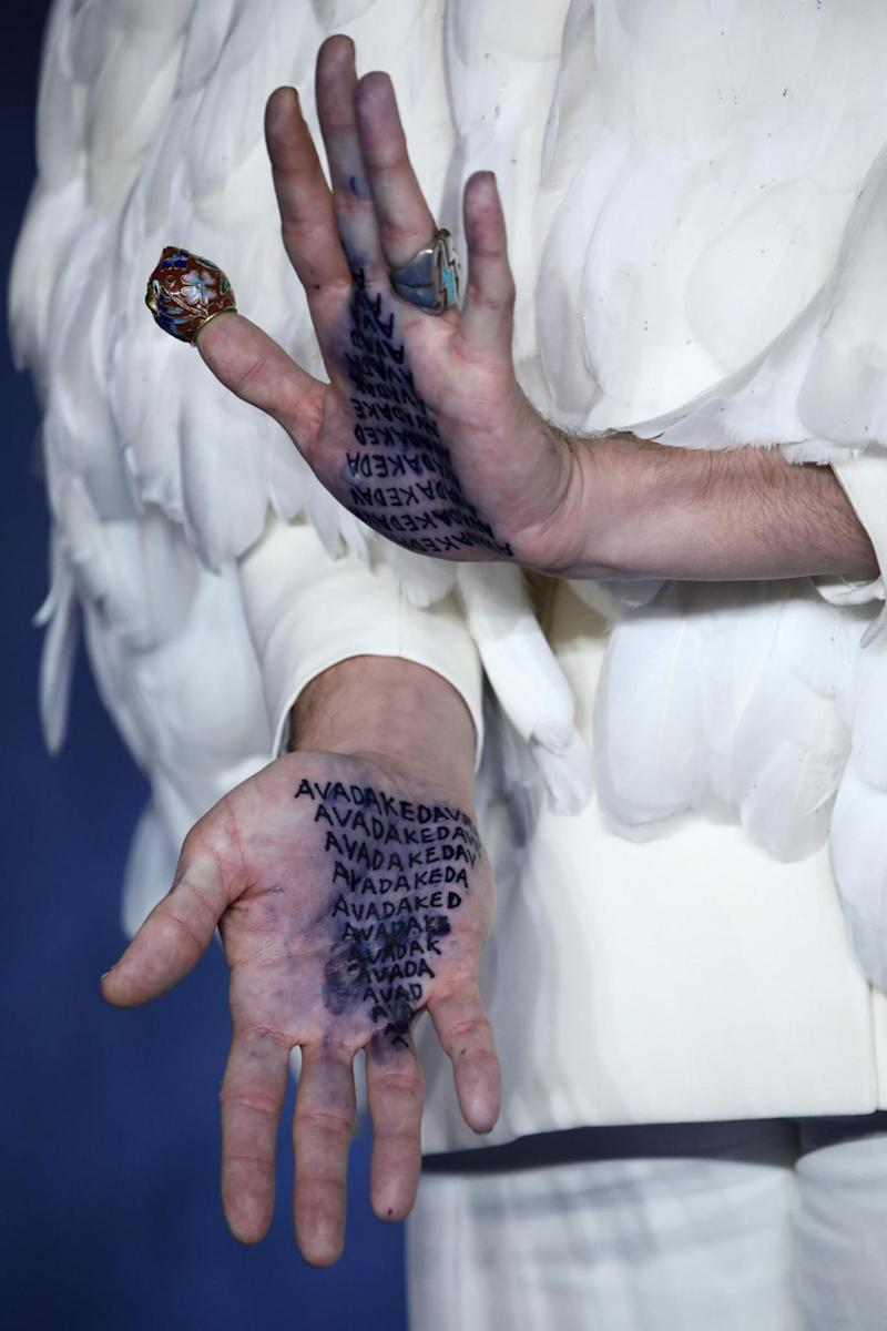 Ezra Miller's hands show the Avada Kedavra killing curse. (Getty Images)