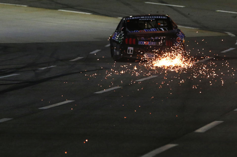 MARTINSVILLE, VIRGINIA - NOVEMBER 01: Kevin Harvick, driver of the #4 Mobil 1 Ford, drives with sparks after an on-track incident on the last lap of the NASCAR Cup Series Xfinity 500 at Martinsville Speedway on November 01, 2020 in Martinsville, Virginia. (Photo by Brian Lawdermilk/Getty Images)