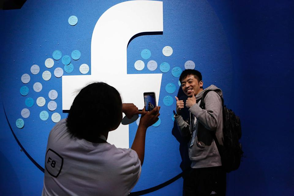 An attendee poses for a picture at the Facebook F8 Conference at McEnery Convention Center in San Jose, California, on April 30, 2019. - Got a crush on another Facebook user? The social network will help you connect, as part of a revamp unveiled Tuesday that aims to foster real-world relationships and make the platform a more intimate place for small groups of friends. (Photo by Amy Osborne / AFP)        (Photo credit should read AMY OSBORNE/AFP via Getty Images)