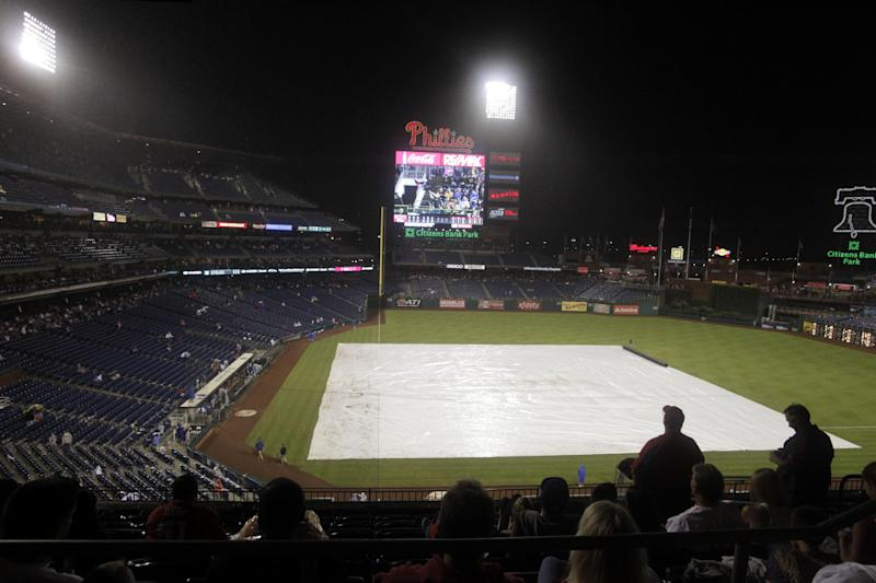 A rain delay stops play during the seventh inning of the New York Mets baseball game against the Philadelphia Phillies, Saturday, Sept. 21, 2013, in Philadelphia. (AP Photo/H. Rumph Jr)
