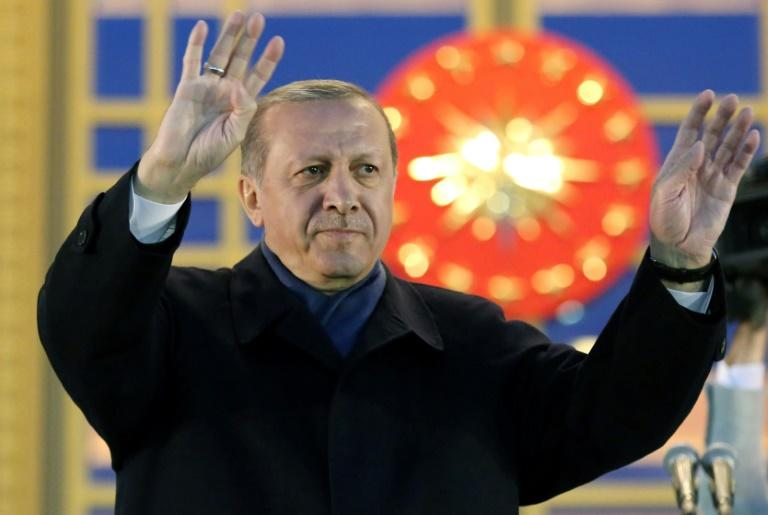 Turkish President Recep Tayyip Erdogan waves to  supporters after winning a referendum that greatly enhanced his powers