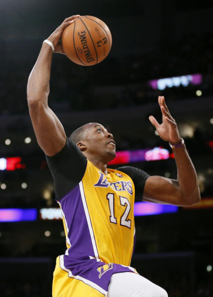 """FILE - In this Feb. 12, 2013, file photo, Los Angeles Lakers' Dwight Howard goes up to dunk against the Phoenix Suns during the second half of an NBA basketball game in Los Angeles. Dallas Mavericks owner Mark Cuban tweeted Friday, July 5, 2013, that it was """"time to get back to work"""" amid multiple media reports that Dallas was out of the running for free agent Howard. (AP Photo/Danny Moloshok, File)"""
