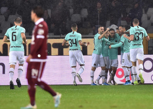 Inter's Lautaro Martinez jubilates with teammates after scoring a goal during the Italian Serie A soccer match between Torino FC and Inter Milan at the Olimpico Grande Torino stadium in Turin, Italy, Saturday, Nov. 23, 2019. (Di Marco/ANSA via AP)