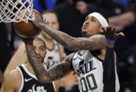 Utah Jazz guard Jordan Clarkson, right, shoots as Los Angeles Clippers forward Nicolas Batum, left, watches during the first half in Game 6 of a second-round NBA basketball playoff series Friday, June 18, 2021, in Los Angeles. (AP Photo/Mark J. Terrill)