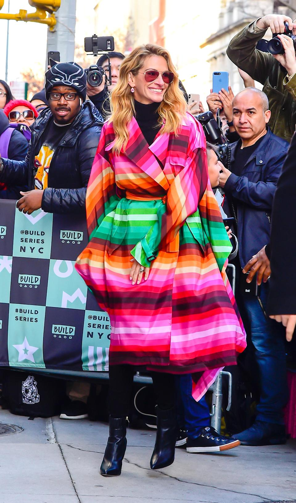 <p>The 51-year-old star proved her style game's as strong as ever in a technicolour coat-dress from Valentino. <em>[Photo: Getty]</em> </p>