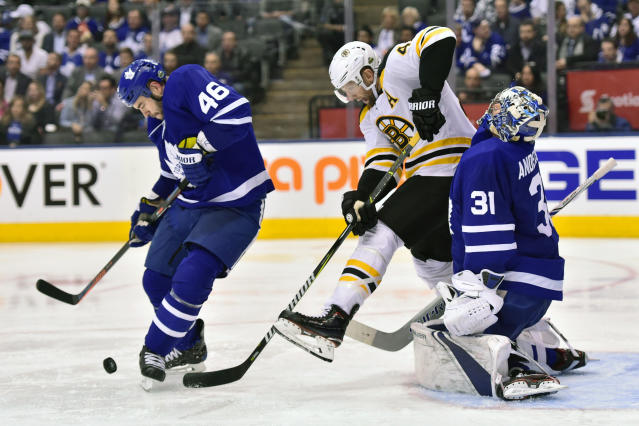 Boston Bruins right wing David Backes (42) picks up a penalty after Toronto Maple Leafs goaltender Frederik Andersen (31) takes an elbow to the head during third period NHL round one playoff hockey action in Toronto on Monday, April 23, 2018. Leafs defenseman Roman Polak (46) looks to clear the puck. (Frank Gunn/The Canadian Press via AP)