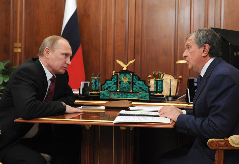 Russian President Vladimir Putin, left, listens to CEO of state-controlled Russian oil company Rosneft Igor Sechin during a meeting in the Kremlin, in Moscow, Russia, Friday, Dec. 20, 2013. After spending 10 years in Russian jails for what many in the West believe were trumped-up offenses, Mikhail Khodorkovsky left prison a free man Friday and immediately flew to Germany. (AP Photo/RIA-Novosti, Mikhail Klimentyev, Presidential Press Service)