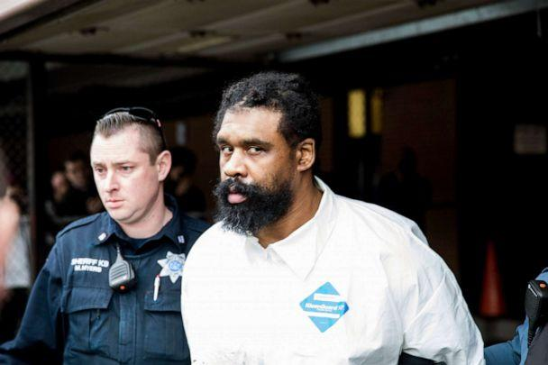 PHOTO: Ramapo police officers escort Grafton Thomas from Ramapo Town Hall to a police vehicle, Sunday, Dec. 29, 2019, in Ramapo, N.Y. Thomas is accused of stabbing multiple people at a rabbi's home in the Orthodox Jewish community north of New York City. (Julius Constantine Motal/AP)