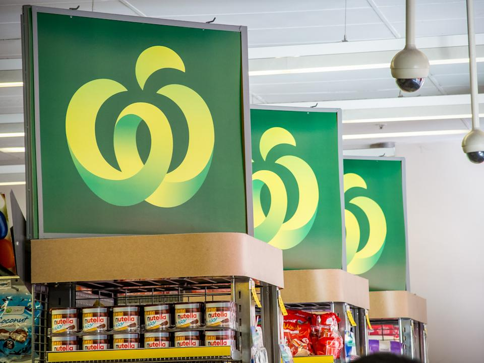 Photo shows Woolworths signs inside a store.