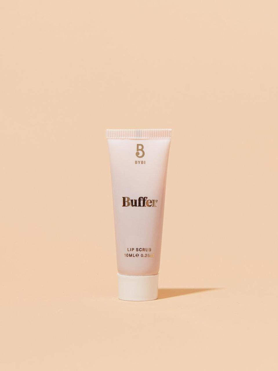 """<h3>Bybi Lip Buffer</h3><br>Packaged in a biodegradable tube made of sugarcane, this 100% natural and vegan lip scrub uses a cocktail of sugar and strawberry extract to slough away dead and dry skin, and sweet almond oil to help restore moisture.<br><br><strong>BYBI Beauty</strong> Lip Buffer, $, available at <a href=""""https://go.skimresources.com/?id=30283X879131&url=https%3A%2F%2Fcredobeauty.com%2Fproducts%2Fbuffer%3Fvariant%3D2403277275148%26currency%3DUSD%26gclid%3DEAIaIQobChMI-f_r_vTO5wIVkYFaBR3lUgd6EAQYASABEgJRNPD_BwE"""" rel=""""nofollow noopener"""" target=""""_blank"""" data-ylk=""""slk:Credo"""" class=""""link rapid-noclick-resp"""">Credo</a>"""