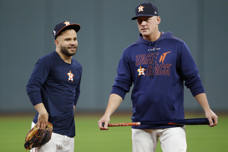 HOUSTON, TEXAS - OCTOBER 29:  Jose Altuve #27 and AJ Hinch #14 of the Houston Astros looks on during batting practice prior to Game Six of the 2019 World Series against the Washington Nationals at Minute Maid Park on October 29, 2019 in Houston, Texas. (Photo by Tim Warner/Getty Images)