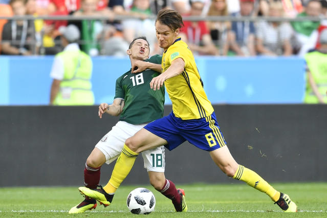 Mexico's Andres Guardado, left, and Sweden's Albin Ekdal challenge for the ball during the group F match between Mexico and Sweden, at the 2018 soccer World Cup in the Yekaterinburg Arena in Yekaterinburg , Russia, Wednesday, June 27, 2018. (AP Photo/Martin Meissner)