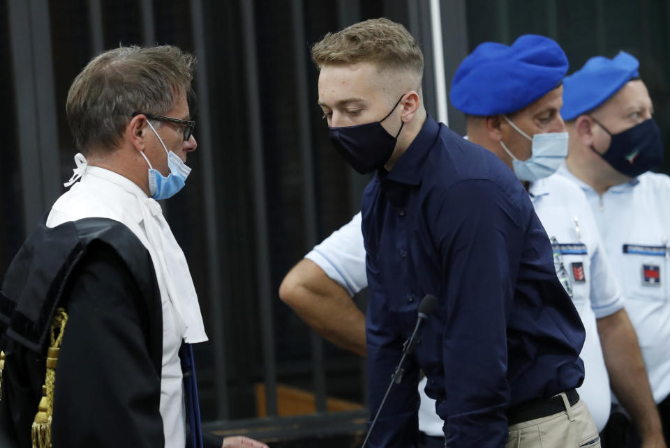 Finnegan Lee Elder, from California, talks with his lawyer Roberto Capra after a break in his trial where he and his friend Gabriel Natale-Hjorth are accused of slaying a plainclothes Carabinieri officer while on vacation in Italy last summer, in Rome, Wednesday, Sept. 16, 2020. (Remo Casilli/Pool Photo via AP)