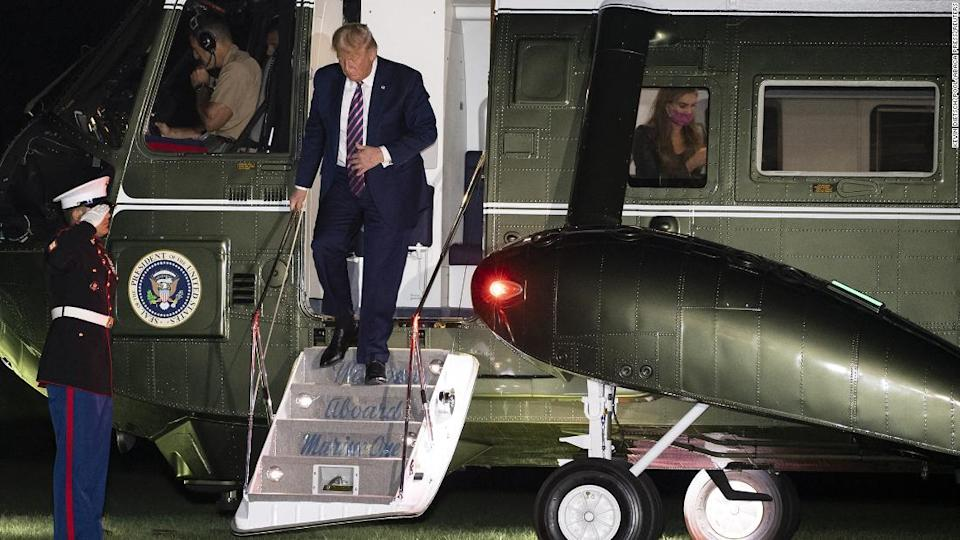 "<p>President Donald Trump walks off Marine One as Hope Hicks is seen through the window as he returns to the White House following a trip to the west coast, on September 14, 2020 in Washington, DC. Photo by Kevin Dietsch/Pool/ABACAPRESS.COM</p><div class=""cnn--image__credit""><em><small>Credit: Kevin Dietsch/Pool/Abaca Press/Reuters / Reuters</small></em></div>"