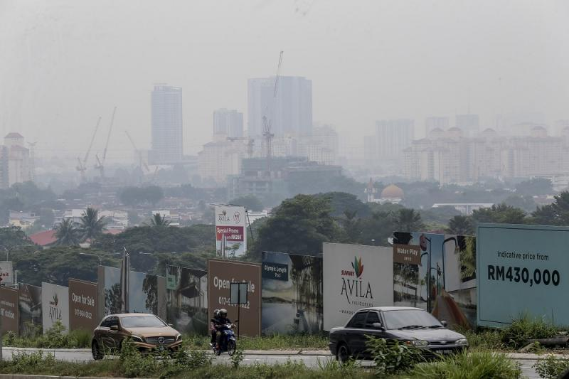 A general view shows residential and commercial buildings shrouded in haze in Kuala Lumpur August 10, 2019. — Picture by Firdaus Latif