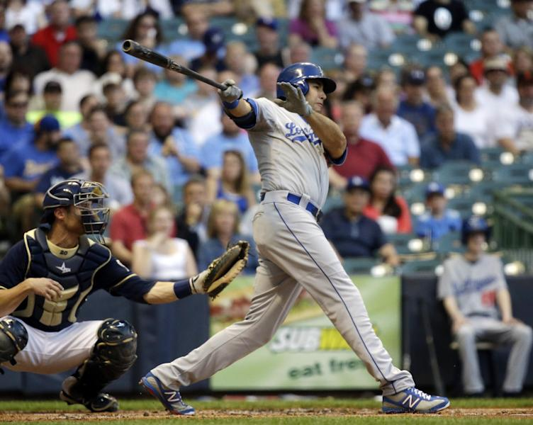 Los Angeles Dodgers' Andre Ethier hits a triple during the second inning of a baseball game against the Milwaukee Brewers Monday, May 20, 2013, in Milwaukee. (AP Photo/Morry Gash)