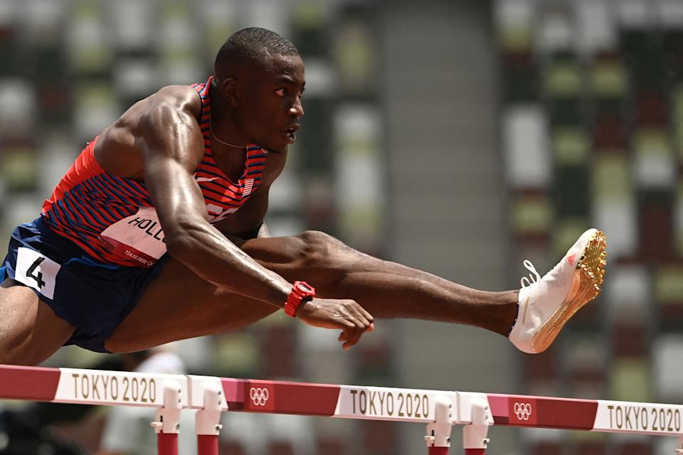 USA's Grant Holloway competes in the men's 110m hurdles semi-finals during the Tokyo 2020 Olympic Games at the Olympic Stadium in Tokyo on August 4, 2021. (Photo by Ina FASSBENDER / AFP) (Photo by INA FASSBENDER/AFP via Getty Images)