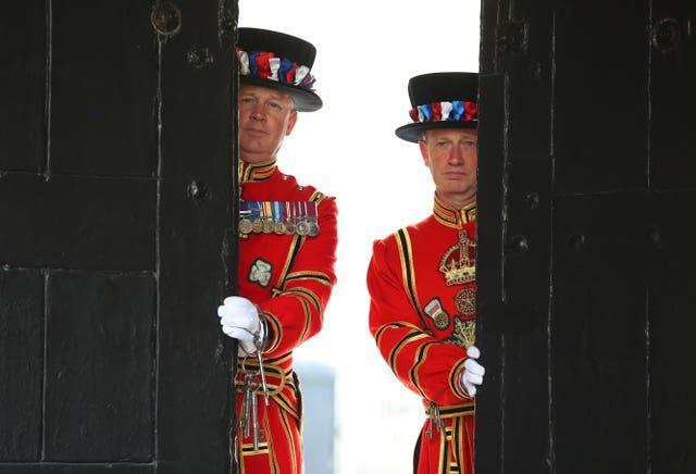 Yeoman Warder Darren Hardy and Yeoman Serjeant Clive Towell open the West Door at the Tower of London