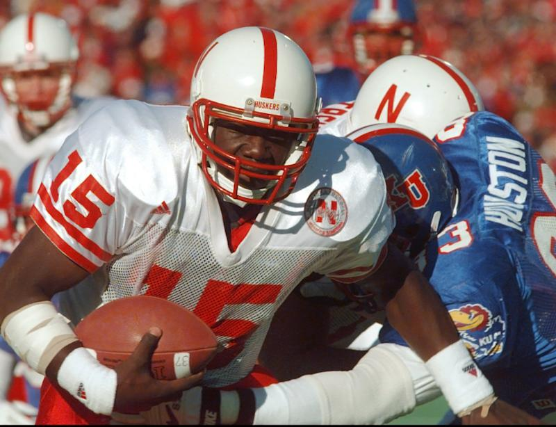 FILE - In this Nov. 11, 1995, file photo, Nebraska quarterback Tommie Frazier (15) runs to inside the one-yard line as Kansas defensive tackle Dewey Houston (83) tries to stop his progress during the first quarter of an NCAA college football game in Lawrence, Kan. Frazier was selected to the College Football Hall of Fame on Tuesday, May 7, 2013.  (AP Photo/Cliff Schiappa, File)