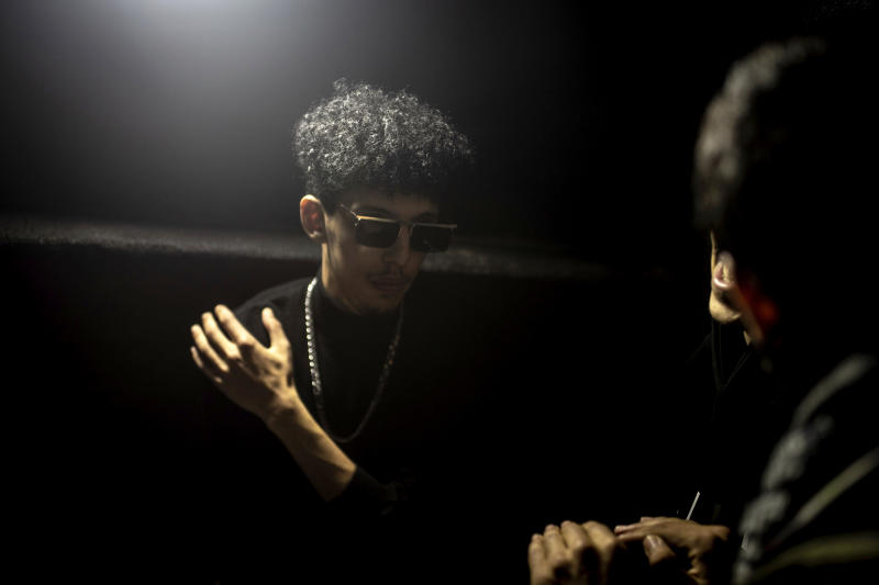 In this Friday, Nov. 22, 2019 photo, Moroccan rapper Abdelkrim Bouhjir, known as Kouz1, prepares to perform in a rap concert as part of the Visa for Music festival in Rabat, Morocco. (AP Photo/Mosa'ab Elshamy)