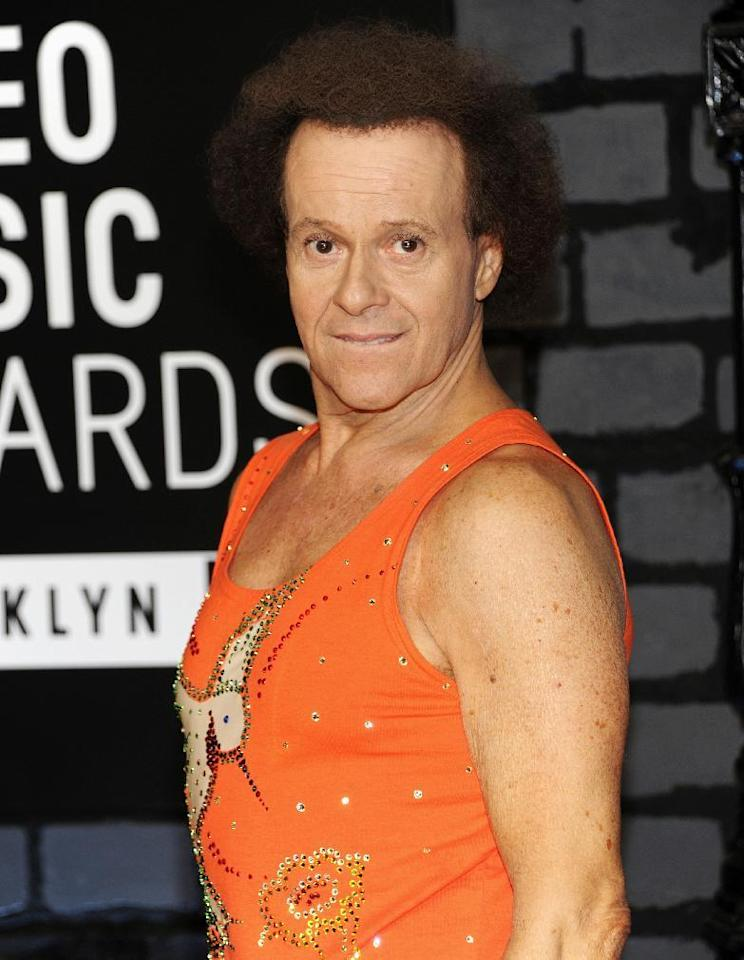 FILE - In this Aug. 25, 2013 file photo, Richard Simmons arrives at the MTV Video Music Awards in the Brooklyn borough of New York. Despite what seems to be a national obsession with the fitness guru's wellbeing, his publicist, manager, brother and two officers from the LAPD have all said the 68-year-old is at home in the Hollywood Hills and doing fine. (Photo by Evan Agostini/Invision/AP, File)
