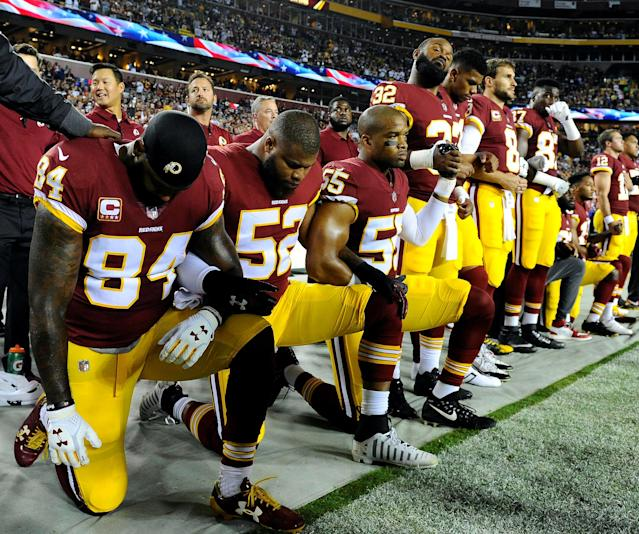 <p>Washington Redskins tight end Niles Paul (84) and linebacker Ryan Anderson (52) and Washington Redskins linebacker Chris Carter (55) kneel with teammates during the playing of the national anthem before the game between the Washington Redskins and the Oakland Raiders at FedEx Field on Sept. 24, 2017. (Photo: Brad Mills-USA TODAY Sports) </p>
