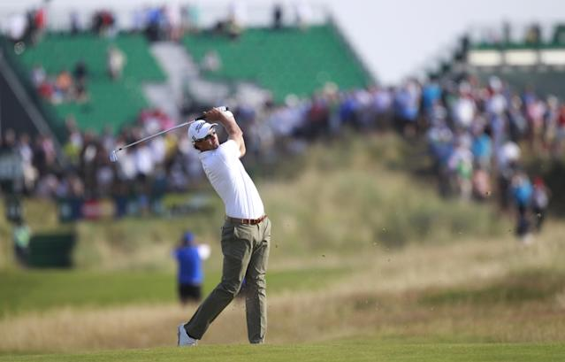 Adam Scott of Australia plays a shot on the 14th fairway during the first day of the British Open Golf championship at the Royal Liverpool golf club, Hoylake, England, Thursday July 17, 2014. (AP Photo/Peter Morrison)