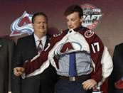 June 23, 2017; Chicago, IL, USA; Cale Makar puts on a team jersey after being selected as the number four overall pick to the Colorado Avalanche in the first round of the 2017 NHL Draft at the United Center. Mandatory Credit: David Banks-USA TODAY Sports