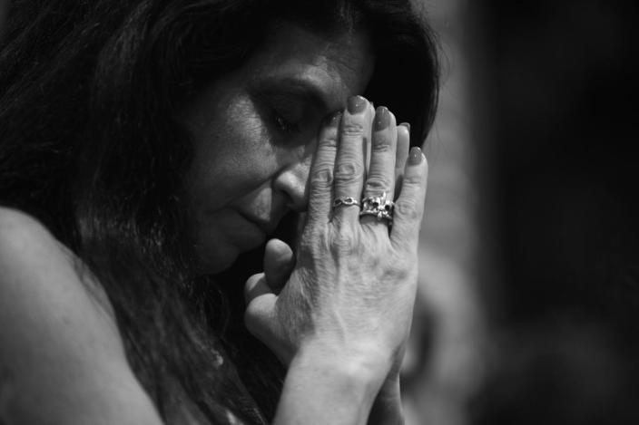 <p>A delegate bows her head during the invocation at the RNC Convention in Cleveland, OH. on July 21, 2016. (Photo: Khue Bui for Yahoo News)</p>