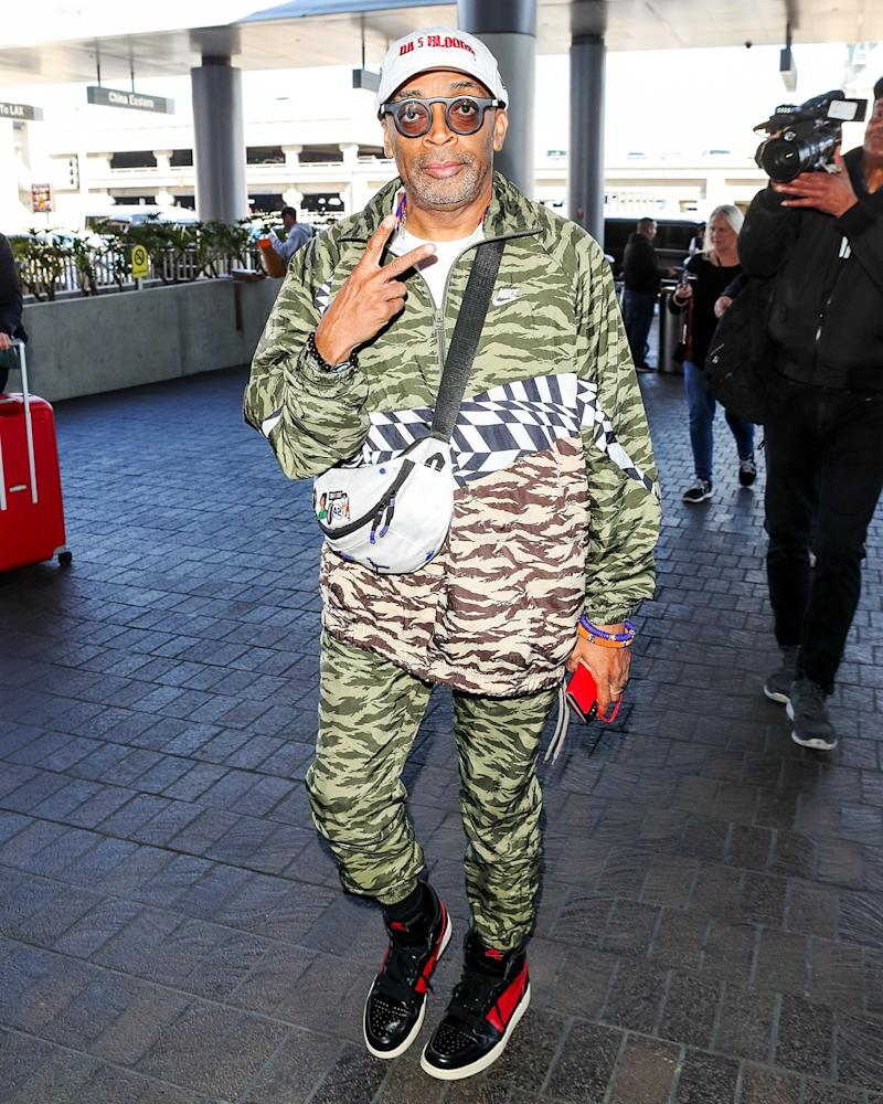 If we're not mistaken, Spike Lee's bag is juuuuust the right size to hold his brand-new Oscar.