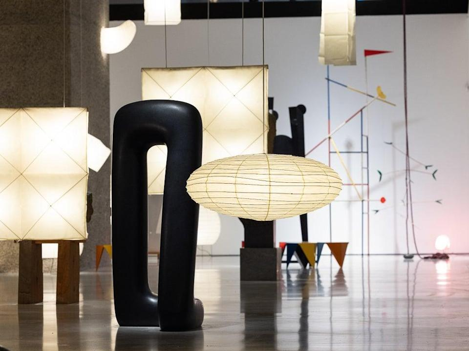 A selection of the 200 versions of the Akari lampshade illuminates the space (Tim Whitby/Getty)