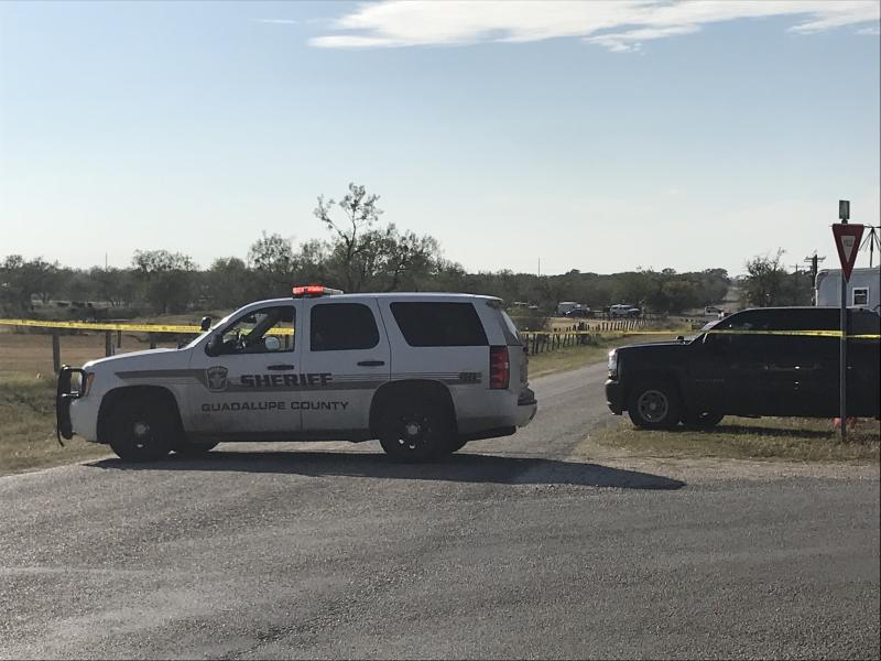 Police block a road in Sutherland Springs, Texas, after a gunman shot dozens of people at a nearby church on Sunday. Sutherland Springs is located about 35 miles east of San Antonio.  (SUZANNE CORDEIRO via Getty Images)
