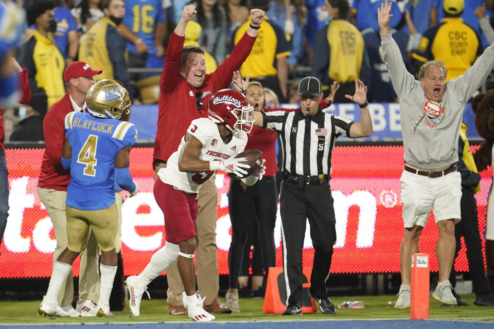 Fresno State wide receiver Erik Brooks (3) makes a touchdown catch next to UCLA defensive back Stephan Blaylock (4) during the second half of an NCAA college football game Sunday, Sept. 19, 2021, in Pasadena, Calif. (AP Photo/Marcio Jose Sanchez)