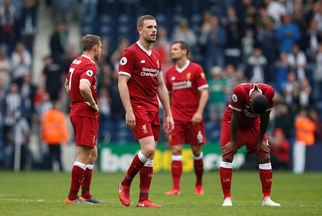 """Soccer Football - Premier League - West Bromwich Albion v Liverpool - The Hawthorns, West Bromwich, Britain - April 21, 2018 Liverpool's Jordan Henderson and team mates look dejected after the match REUTERS/Andrew Yates EDITORIAL USE ONLY. No use with unauthorized audio, video, data, fixture lists, club/league logos or """"live"""" services. Online in-match use limited to 75 images, no video emulation. No use in betting, games or single club/league/player publications. Please contact your account representative for further details."""