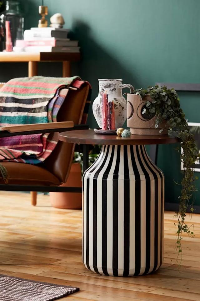 "<p>Chic, modern, and totally trendsetting, this <a href=""https://www.popsugar.com/buy/Bandera-Side-Table-487922?p_name=Bandera%20Side%20Table&retailer=urbanoutfitters.com&pid=487922&price=299&evar1=casa%3Aus&evar9=46580921&evar98=https%3A%2F%2Fwww.popsugar.com%2Fhome%2Fphoto-gallery%2F46580921%2Fimage%2F46581437%2FBandera-Side-Table&list1=shopping%2Curban%20outfitters%2Cfall%2Cfurniture%2Cfall%20decor%2Chome%20shopping&prop13=mobile&pdata=1"" rel=""nofollow"" data-shoppable-link=""1"" target=""_blank"" class=""ga-track"" data-ga-category=""Related"" data-ga-label=""https://www.urbanoutfitters.com/shop/bandera-side-table?category=SEARCHRESULTS&amp;color=018&amp;type=REGULAR&amp;size=ONE%20SIZE&amp;quantity=1"" data-ga-action=""In-Line Links"">Bandera Side Table</a> ($299) is what your living room has always wanted.</p>"