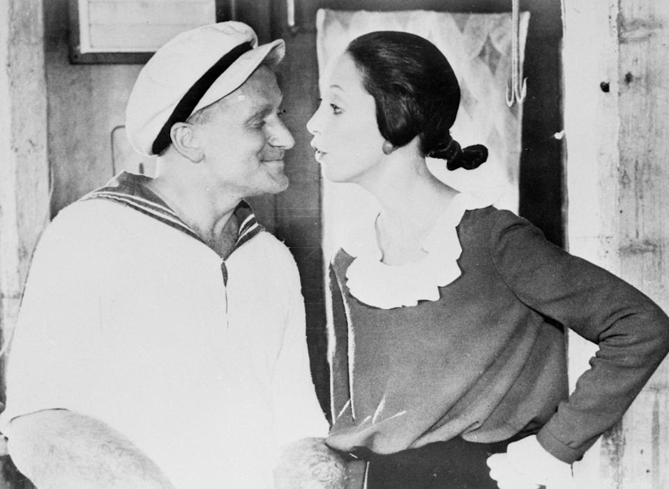 Comedy actor Robin Williams, as Popeye, and Shelley Duvall as Olive Oil. They star in the film adaptation of the famous comic strip, which opens at the Odeon in Leicester Square, London, tonight.   (Photo by PA Images via Getty Images)