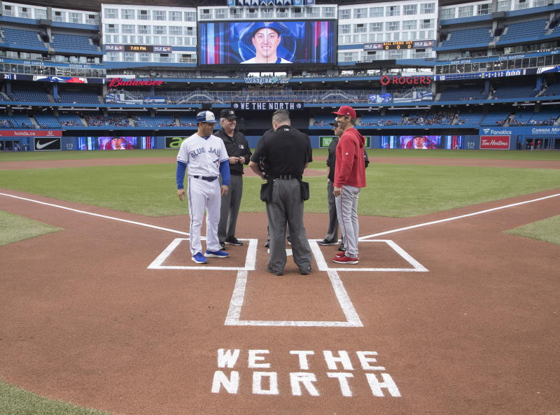 """""""We The North"""" is written behind home plate in chalk, in honor of the Toronto Raptors' NBA basketball championship win, at a Toronto Blue Jays game against the Los Angeles Angels in Toronto, Monday, June 17, 2019. (Fred Thornhill/The Canadian Press via AP)"""