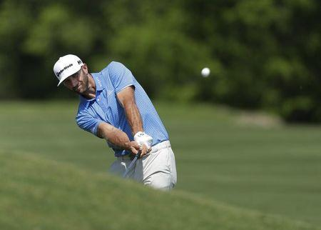 Mar 26, 2017; Austin, TX, USA; Dustin Johnson of the United States plays against Jon Rahm of Spain during the final round of the World Golf Classic - Dell Match Play golf tournament at Austin Country Club. Mandatory Credit: Erich Schlegel-USA TODAY Sports