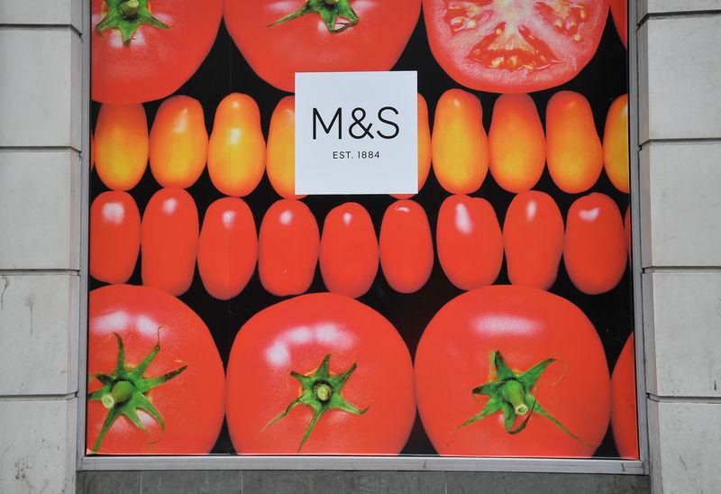 A Marks and Spencer logo is seen on a store in London