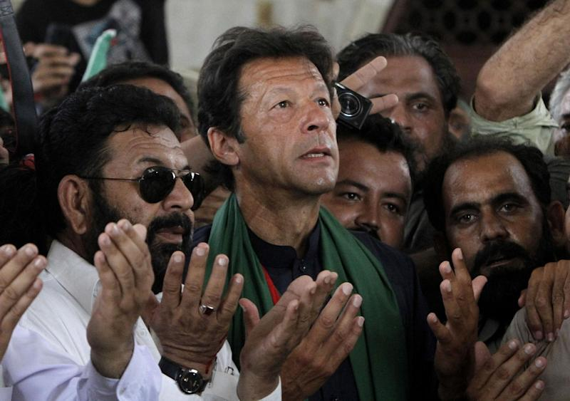 Imran Khan, Pakistan's cricket star-turned-politician offers prayers at the mausoleum of Mohammad Ali Jinnah, founder of Pakistan during an election campaign in Karachi, Pakistan, Tuesday, May 7, 2013. Pakistan is scheduled to hold parliamentary elections on May 11, the first transition between democratically elected governments in a country that has experienced three military coups and constant political instability since its creation in 1947. (AP Photo/Shakil Adil)