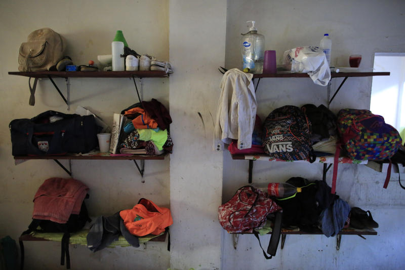Migrants belongings sit on the shelves in what was the shelter kitchen but now houses women and children, at the Good Shepherd migrant shelter in Tapachula, Mexico, Tuesday, June 18, 2019. Most of the migrants at Good Shepherd are seeking refugee status in Mexico and awaiting documentation that could eventually allow them to find work and settle in the country. (AP Photo/Rebecca Blackwell)