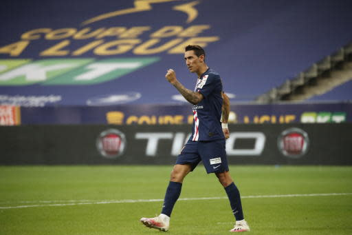 PSG's Angel Di Maria, celebrates after scoring a penalty kick against Lyon, during the French League Cup soccer final match between Paris Saint Germain and Lyon at Stade de France stadium, in Saint Denis, north of Paris, Friday, July 31, 2020. Rafael received the red card. (AP Photo/Francois Mori)